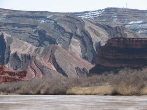 The San Juan slides through folded geology under a hint of winter.